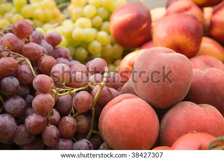 Grapes and peaches on a market stall