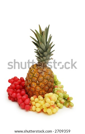 Grapes and pineapple isolated on white background - stock photo