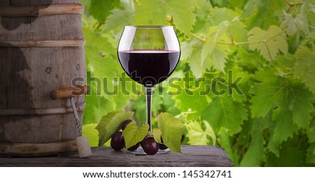 grapes and wine glass on a wooden vintage table