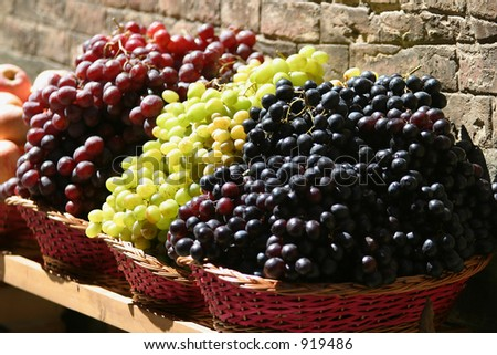 Grapes for sale at a market on the streets of Siena, Tuscany, Italy - stock photo