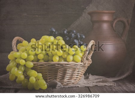 Grapes in a basket in rustic style. Selective focus, toned.
