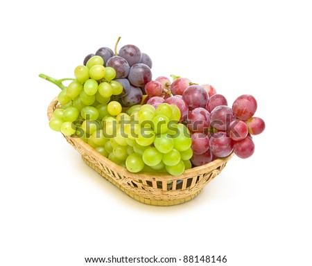 grapes in a basket on a white background closeup - stock photo