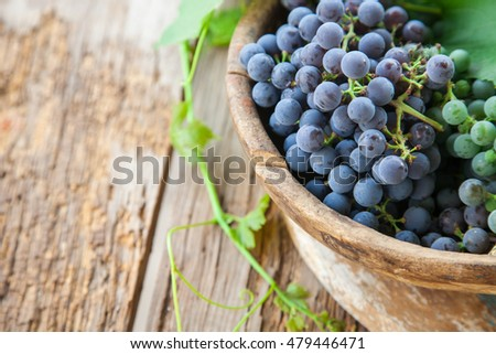 grapes in a bowl on a table, selective focus