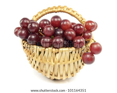 grapes in wicker basket on a white background - stock photo