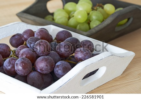 Grapes in wooden trays