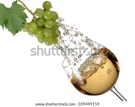 Grapes juice flow in a white wine glass - stock photo
