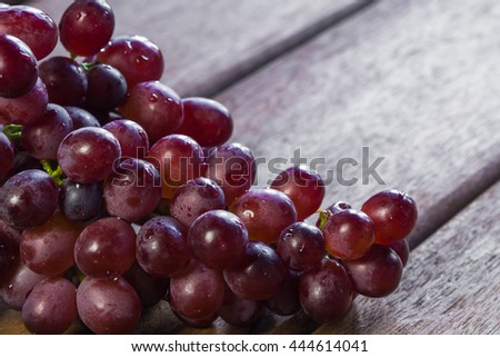 Grapes on a old wooden table. - stock photo
