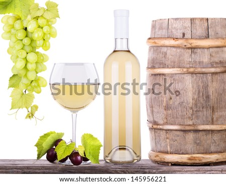 grapes on a wooden vintage barrel  and wine glass with bottle isolated on a white background