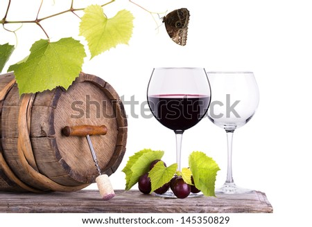 grapes on a wooden vintage barrel with corkscrew, butterfly and wine glass isolated on a white background - stock photo