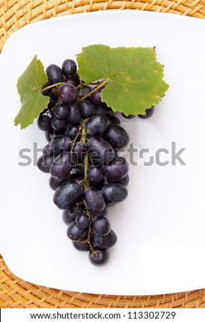 Grapes on white plate with copy space