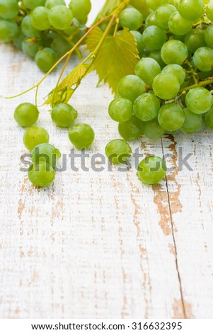 Grapes on white wooden vintage table