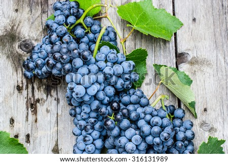 Grapes on wooden background - stock photo