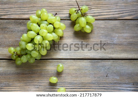 Grapes on wooden boards, food closeup