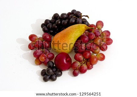grapes, pear and plum isolated