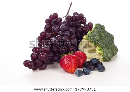 grapes, strawberries and broccoli, three of the best antioxidants on a white board