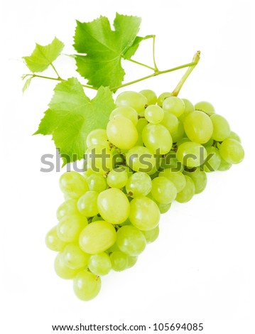Grapes with fresh leaves isolated on white background. - stock photo