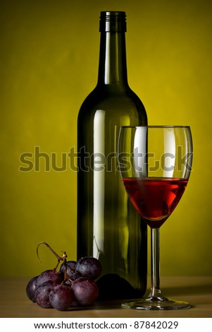 grapes with red wine glass and a bottle of wine