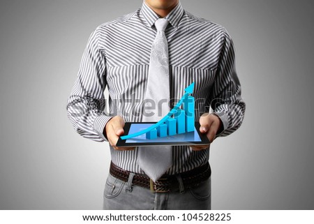graph on a tablet isolated  with in hand businessmen - stock photo