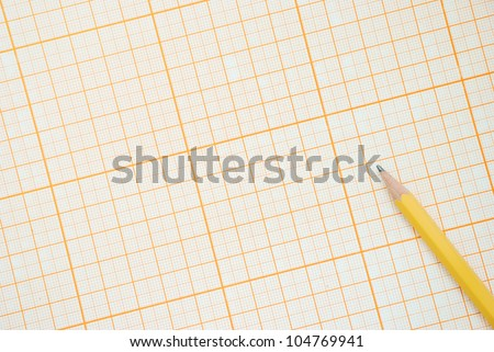 Graph paper with pencil, top view