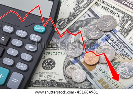 Graph showing a decline in the economy of United States bank notes and coins with a calculator - stock photo