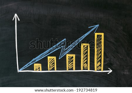 Graph showing rise in profits or earnings drawn over with chalk , - stock photo
