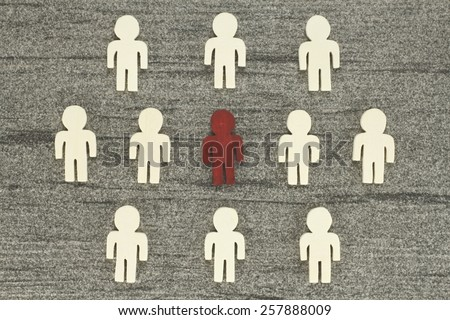 Graph with many figures - including a special individual. Discover and recruit symbolizes the talents - stock photo