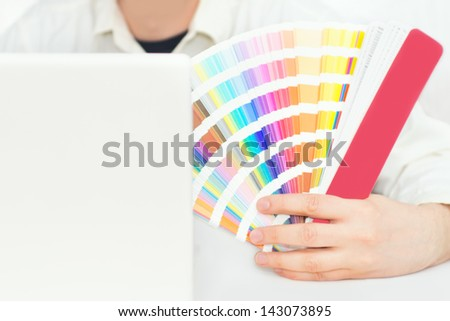 Graphic design, printing, advertising Graphic designer with pantone palette - stock photo