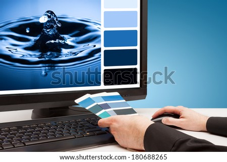 Graphic designer at work. Color samples. Drop water image. - stock photo