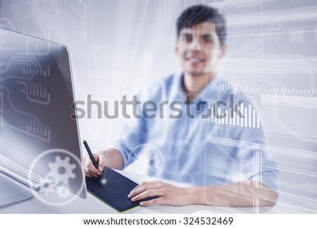 Graphic designer drawing something on tablet at office - stock photo