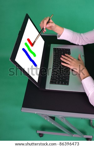 Graphic designer painting on screen. - stock photo