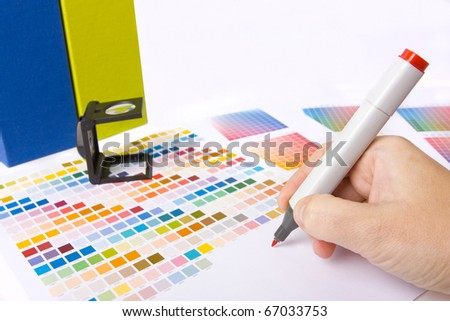 graphic designer, printer or ilustrator with colour swatches