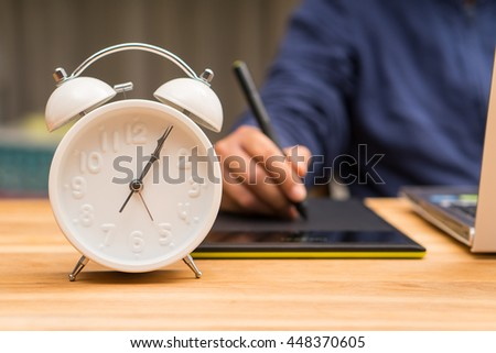 Graphic designer using pen mouse, overtime work hard concept - stock photo