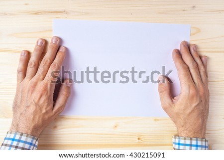 Graphic designer with blank paper on office desk as copy space, top view - stock photo