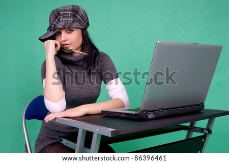 Graphic designer with brush and laptop. - stock photo