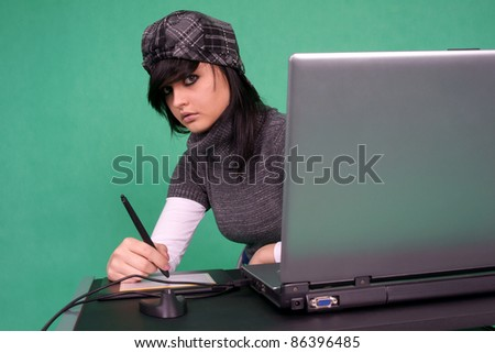 Graphic designer working with tablet pen. - stock photo
