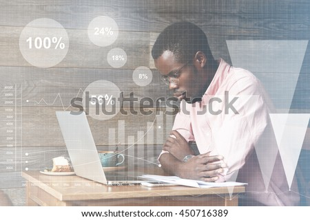 Graphic icons, double exposure. Young African American accounting clerk making an annual financial report, drawing diagrams, looking at laptop screen with thoughtful and serious face expression - stock photo
