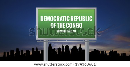 Graphic of a green Democratic Republic of the Congo Straight Ahead sign on silhouette skyline and sunset background  - stock photo