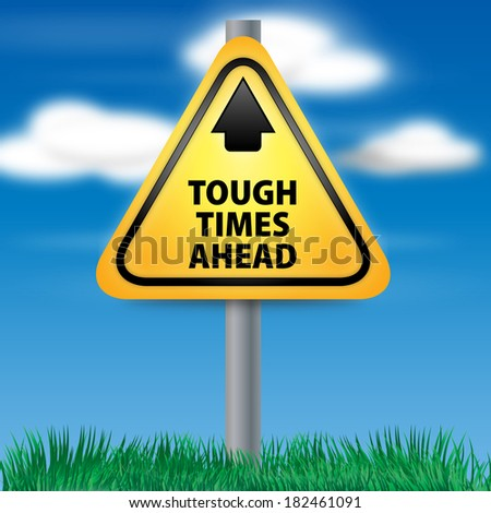 Graphic of a yellow Tough Times Ahead Road Sign on Cloud Background - stock photo