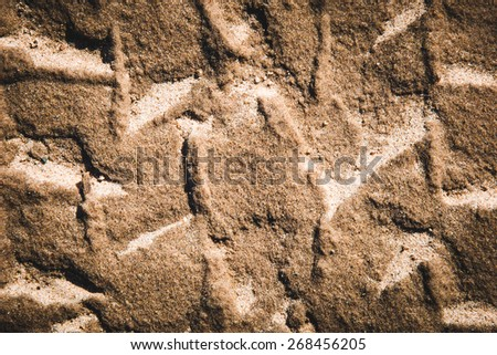 Graphic photo of a tire track in the sand - stock photo