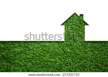 graphic shape of House in green field - stock photo