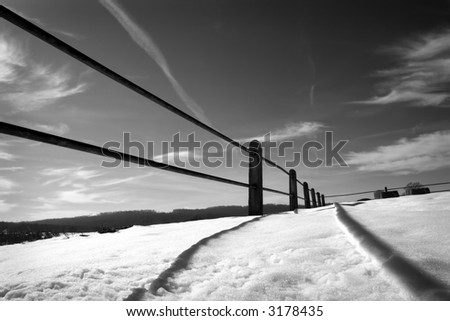 graphical black & white photograph of a snow covered field - stock photo