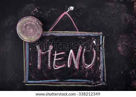 Graphical representation of the word with chalk on blackboard, menu - stock photo