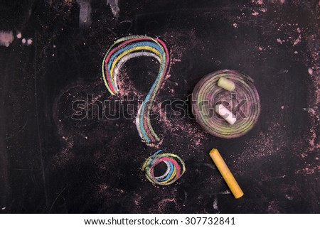 Graphical representation with chalk on blackboard question mark symbol - stock photo