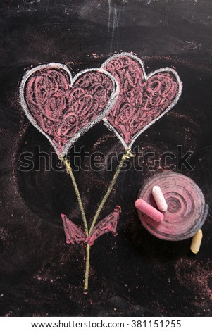 Graphical representation with chalk on blackboard symbol of love, the heart - stock photo
