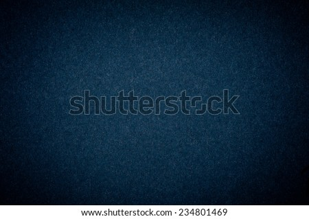 Graphite flat cardboard texture abstract with dark vignette, paper plain grainy smooth surface background in horizontal orientation, nobody.