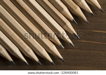 Graphite pencils on a wooden background - stock photo