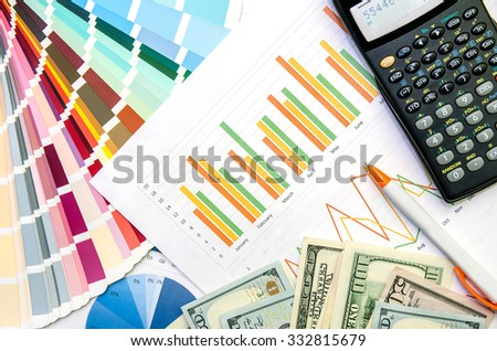 Graphs and Calculator, pen and money - stock photo