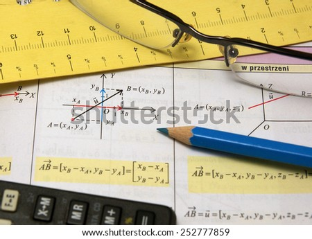 Graphs and charts of vectors (vector) theory together with glasses, calculator and blue pencil - stock photo