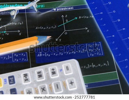 Graphs and charts of vectors (vector) theory together with glasses, calculator and pencil - negative - stock photo