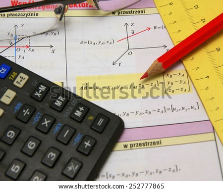 Graphs and charts of vectors (vector) theory together with glasses, calculator and red pencil - stock photo